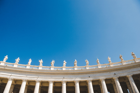 bottom view of statues at St Peters Square on blue sky in Vatican, Italy Reklamní fotografie