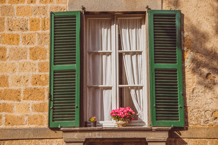 window with flowers on windowsill in Orvieto, Rome suburb, Italy