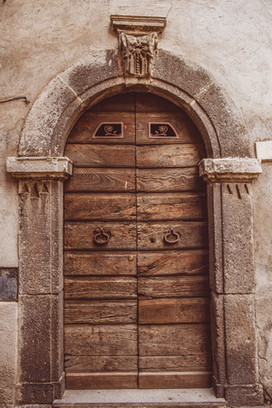 old wooden doors in Orvieto, Rome suburb, Italy