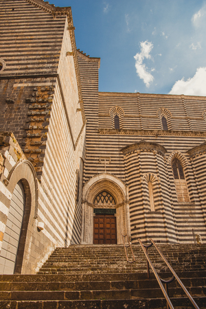 low angle view of stairs and walls of orvieto cathedral in Orvieto, Rome suburb, Italy Stock Photo