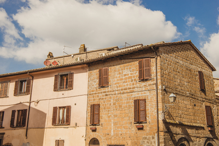 old buildings and cloudy sky in Orvieto, Rome suburb, Italy