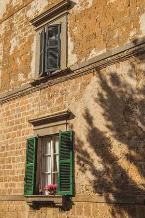 tree shadow on building in Orvieto, Rome suburb, Italy Stock Photo