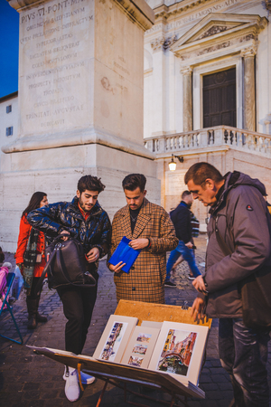 ROME, ITALY - 10 MARCH 2018: artist selling paintings on square Stock Photo - 106639534