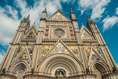 low angle view of facade of ancient historical Orvieto Cathedral in Orvieto, Rome suburb, Italy Stock Photo