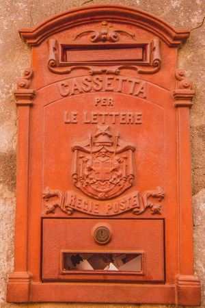 red post box on wall in Orvieto, Rome suburb, Italy
