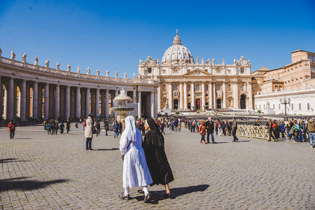 VATICAN, ITALY - 10 MARCH 2018: nuns walking by St. Peters square