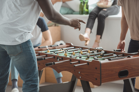 cropped image of man pointing by finger on table football board Stock Photo