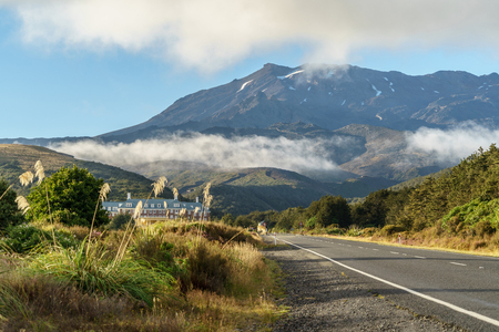 Mansion and empty road to giant mountain, Tongariro National Park, New Zealand