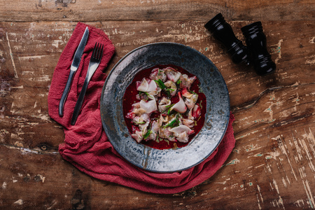 top view of gourmet Ceviche with dorado in plate on wooden table Stock Photo