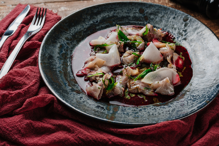 close-up view of gourmet ceviche with Dorado and daikon in plate Stock Photo