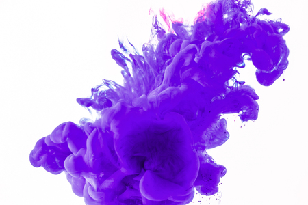 creative design with purple paint flowing in water, isolated on white