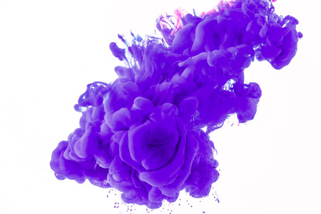 creative design with flowing purple paint in water, isolated on white