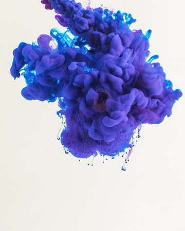 creative design with flowing blue and purple smoky ink, isolated on white
