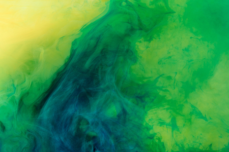 artistic background with green paint flowing in water Reklamní fotografie - 106793718