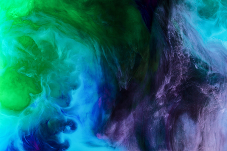 creative background with blue, purple and green paint swirls looks like space