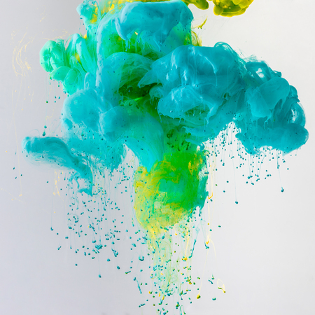 design with flowing turquoise, blue and green paint in water with drops, isolated on grey Banco de Imagens