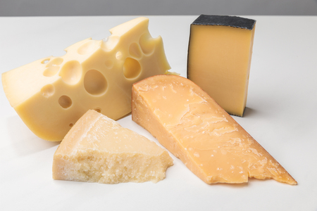 Closeup view of different types of cheese on gray 写真素材