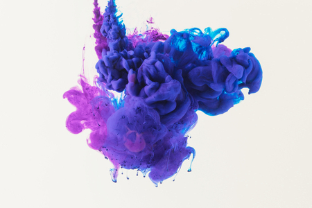 abstract design with flowing blue and purple ink in water, isolated on white