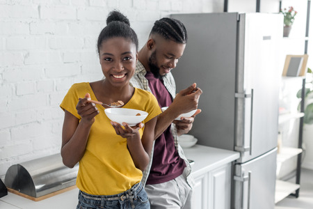 smiling african american couple having breakfast at kitchen Stok Fotoğraf