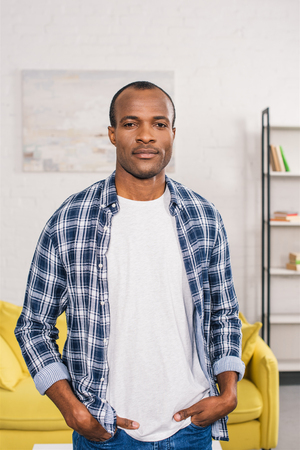 handsome young african american man looking at camera at home 版權商用圖片