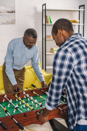 happy senior father and adult son playing table football at home Stok Fotoğraf