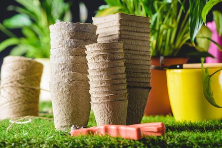 closeup shot of stacks of flower pots and secateurs on grass Banco de Imagens