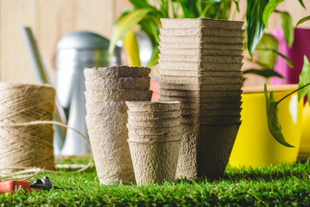 closeup shot of stacks of different flower pots on grass Stock Photo