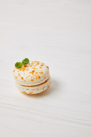 closeup shot of macaron on white wooden tabletop
