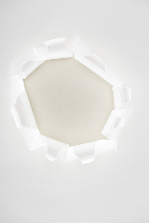 White ripped paper with copy space in center