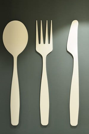 Set of decorative wooden cutlery on grey background