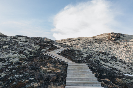 empty wooden walkway and snow at sunny day in iceland, Hraunfossar 写真素材