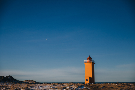 beautiful view of lighthouse and icelandic seacoast at sunny day, stafnesviti, reykjanes, iceland