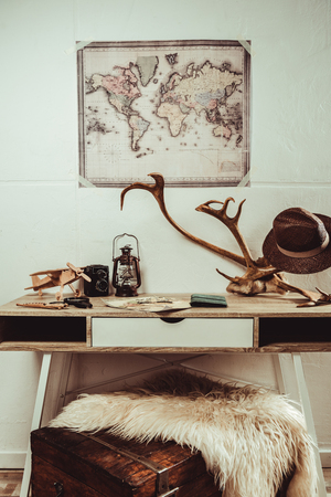 close up view of table with map, magnifying glasses and various decorations Banco de Imagens