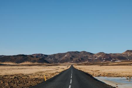 empty asphalt road in beautiful icelandic landscape, reykjanes, iceland