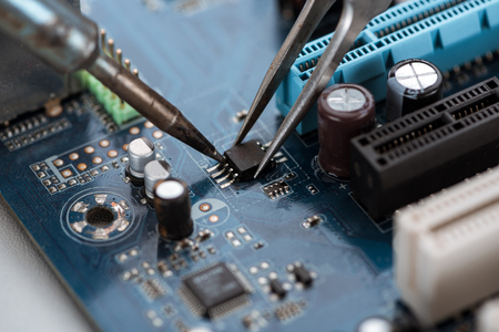 Soldering typical desktop computer baseboard close-up view 写真素材