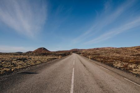 empty asphalt road in majestic icelandic landscape at sunny day, reykjanes, iceland Stock Photo