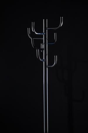 empty coat stand isolated on black Stock Photo