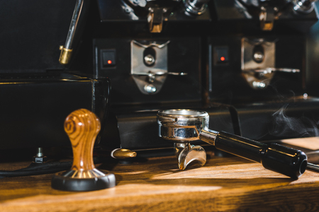 close-up view of modern coffee machine on wooden table in coffee shop Stock Photo