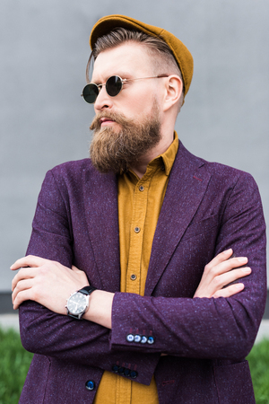 Man with vintage mustache and beard wearing sunglasses