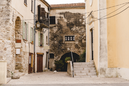 narrow street with ancient buildings at old european town, Sainte Agnes, France