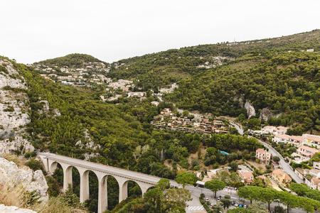 aerial view of beautiful bridge at small european town in hills, Fort de la Revere, France
