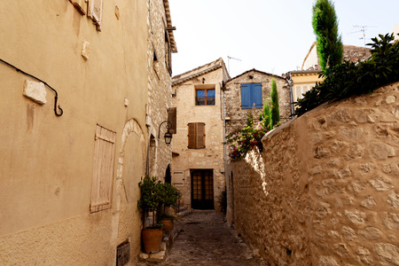 narrow street with small houses at old town, Antibes, France