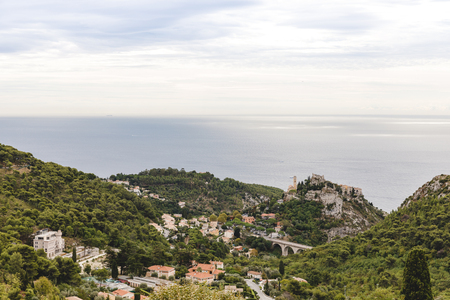 aerial view of beautiful small town on hills above seashore, Fort de la Revere, France