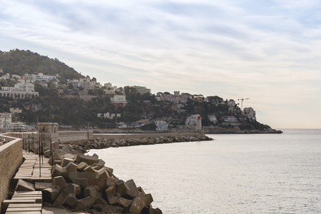 NICE, FRANCE - 17 SEPTEMBER 2017: scenic view of seashore of european coastal town with lighthouse Stok Fotoğraf