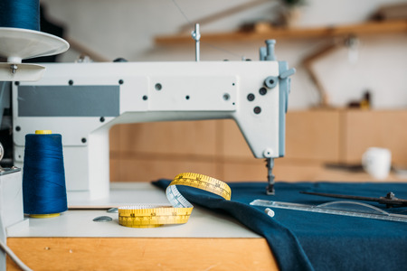 tape measure on sewing machine at sewing workshop Stock Photo