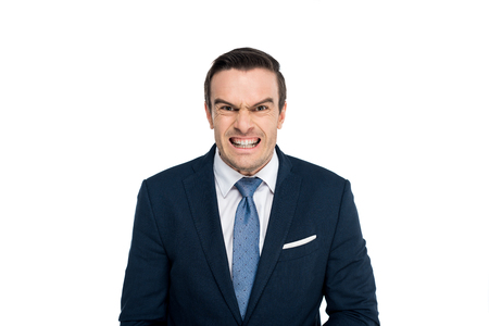 angry middle aged businessman looking at camera isolated on white Stock Photo