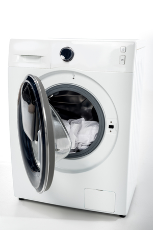 open washing machine with clothes on white