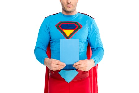 cropped shot of man in superhero costume holding blank box with soap powder isolated on white Imagens