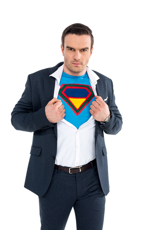 businessman showing superhero costume under suit and looking at camera isolated on white Stock Photo