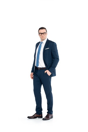 full length view of confident businessman in eyeglasses and suit standing with hand in pocket and looking at camera isolated on white Stok Fotoğraf - 106806746